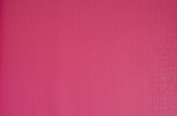 Pink Yoga Mat Rubber Texture Background.  Fitness concept, active lifestyle, body care concept