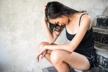 Depressed prostitute Asian woman in brothel