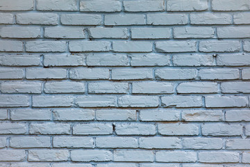 old  blue toned brick wall with repeating pattern