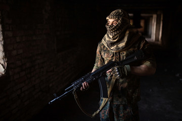 The Arab soldier with the AK-47 Kalashnikov assault rifle
