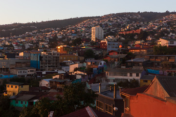 View of colorful houses in city at sunrise