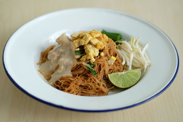 COCONUT RICE NOODLE Stir fried coconut rice noodle served with vegetable and coconut sauce. Popular thai street food.