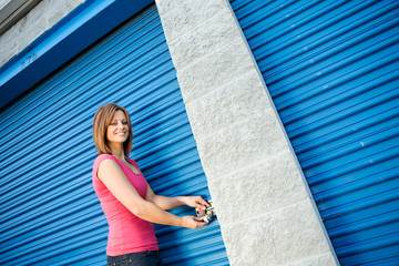Storage: Woman Putting Lock on Unit Door
