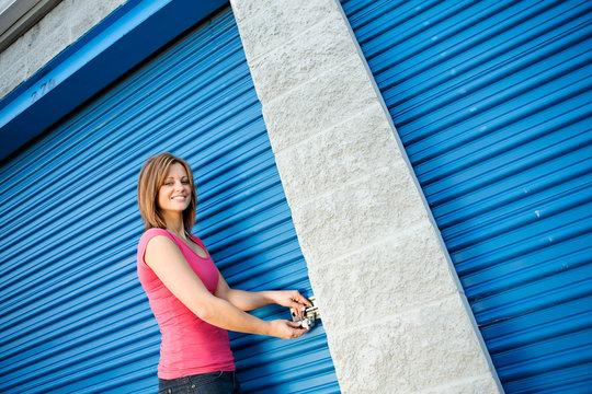 Storage: Woman Putting Lock on Unit Door