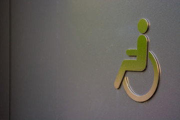 disabled sign on toilet door