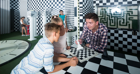 Parents with their children are visiting the escape room