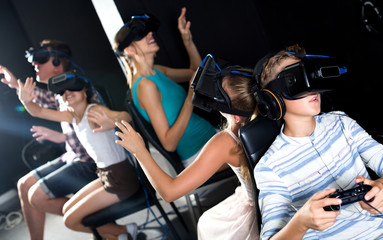 Family of five are watching video in virtual reality glasses