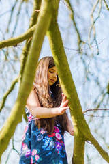 portrait of a young girl playing in a tree