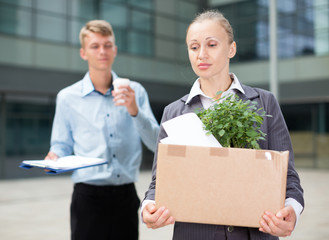 Female manager in suit is standing upset near office