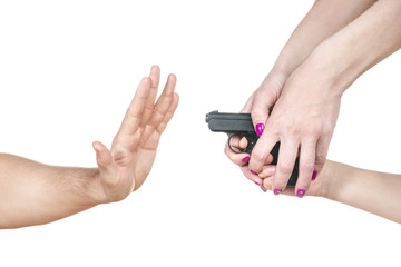 Adult stops a hand of the child with a gun , isolated on a white background