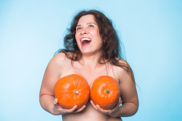 Pumpkins on a female breast - concept silicone breast and plastic surgery.