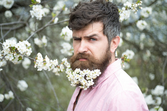 Good smelling bearded man with flowers