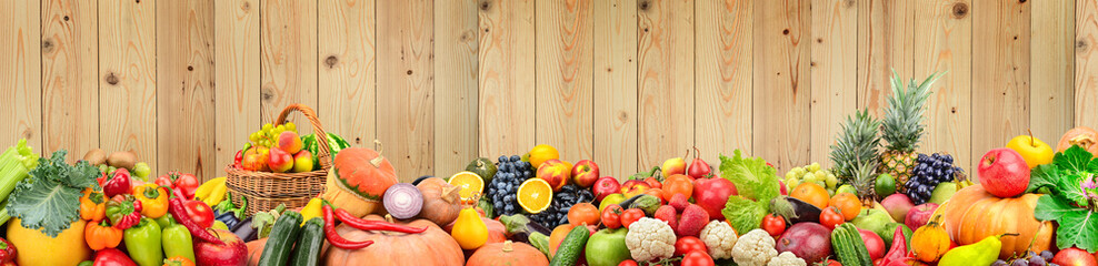 Printed roller blinds Fruits Panoramic photo healthy vegetables and fruits against light wooden wall.