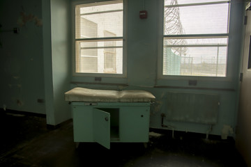 Treatment table in prison hospital treatment room