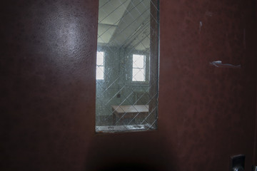 Table behind mesh windows in prison