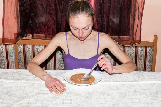 Anorexic girl, Young skinny anorexic girl with anorexia refusing to eat