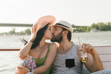 Romantic couple kissing by the river