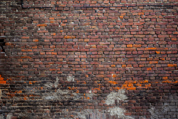 Red old worn brick wall