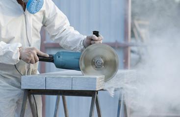 Worker cuts stone grinding machine Wall mural