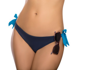 female body part in a swimsuit and sunglasses, body part of slim woman isolated on white