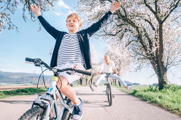 Family active leisure - father and son have a fun when they ride a bicycles