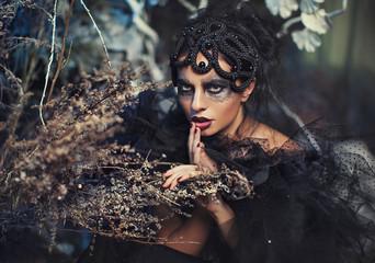 Brunette girl in black dress in artistic image