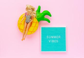 Summer Vibes Letter Board Quote, Doll with Mini Pineapple Pool Float on Pink Background