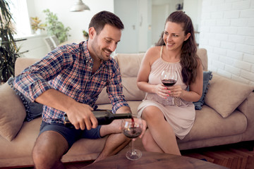 Young couple in love drink red wine