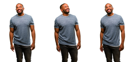 African american man with beard confident and happy with a big natural smile laughing looking up
