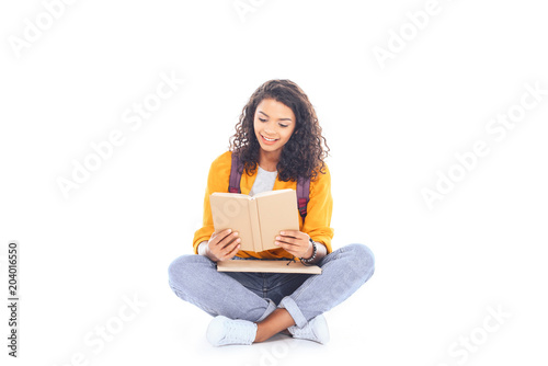 African American Student With Backpack Reading Book Isolated
