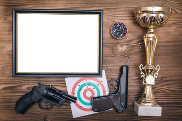 Best shooter diploma. First place winner in shooting. Professional shooter certificate mock up. Gun, gold medal and blank photo frame.