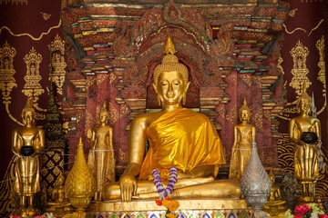 gold image buddha in the old temple Ayutthaya, Thailand