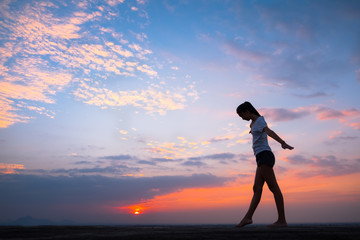 Young asian woman yoga at sunset