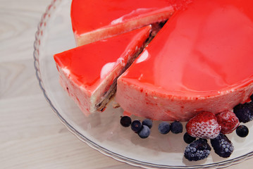 Red Mirror Glazed Fruit Mousse Cake without Decoration. Top view. Iced Berries. Step by Step Cooking Process.