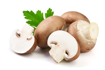 Royal Brown champignon with half and parsley leaf isolated on white background