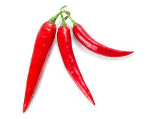 three cayenne chili peppers isolated on white background
