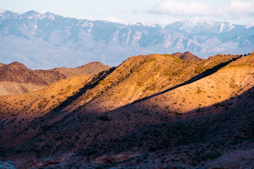 Panorama of a beautiful landscape with mountain ranges at sunset. Kazakhstan