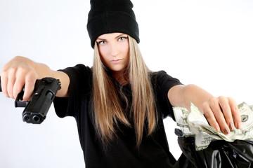 Beautiful girl with a gun imitates a robbery