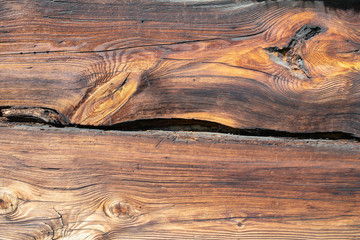 Old wood structure, wood pattern, plank, board. 200 years old wooden wall. Sharp, good visible growth rings, parallel lines and curves
