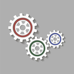 Mechanical gears with a shadow. Vector icon