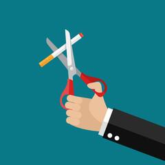 Hands holding scissors cut a cigarettes