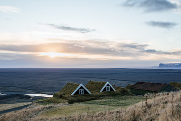 Typical Viking's village. Volcanic landscape with mountains near glacier, Iceland