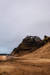 Scenic landscape including houses and cliffs in Iceland