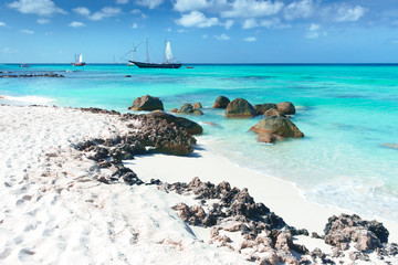 Arashi Beach Aruba Caribbean Sea sand rocks crystal clear turquoise water boats