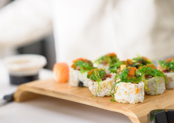 Delicious sushi, japanese food with raw fish, avocado and rice