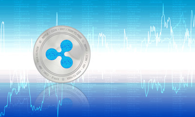 Ripple coin (XRP) cryptocurrency closeup. Stack of blue and silver coins on blue background. Blockchain technology digital payment network for financial transactions. Cyber money.