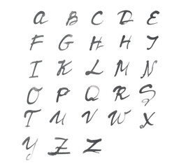 The alphabet written on white paper