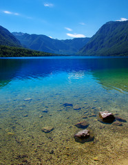 Foto op Canvas Meer / Vijver Mountain lake with clear water