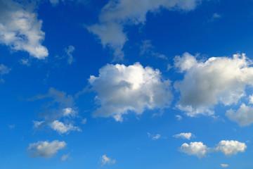 cloudscape with wispy cloud in blue sky