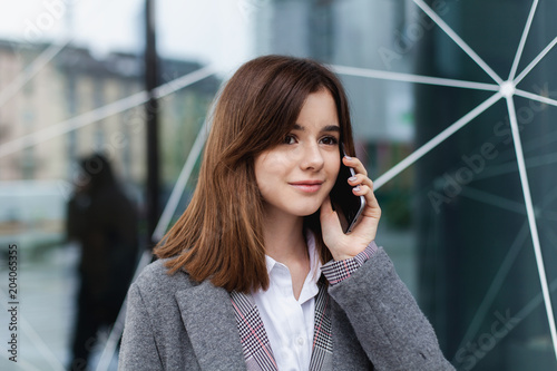 Happy Businesswoman Calling Mobile Phone Near Office Young